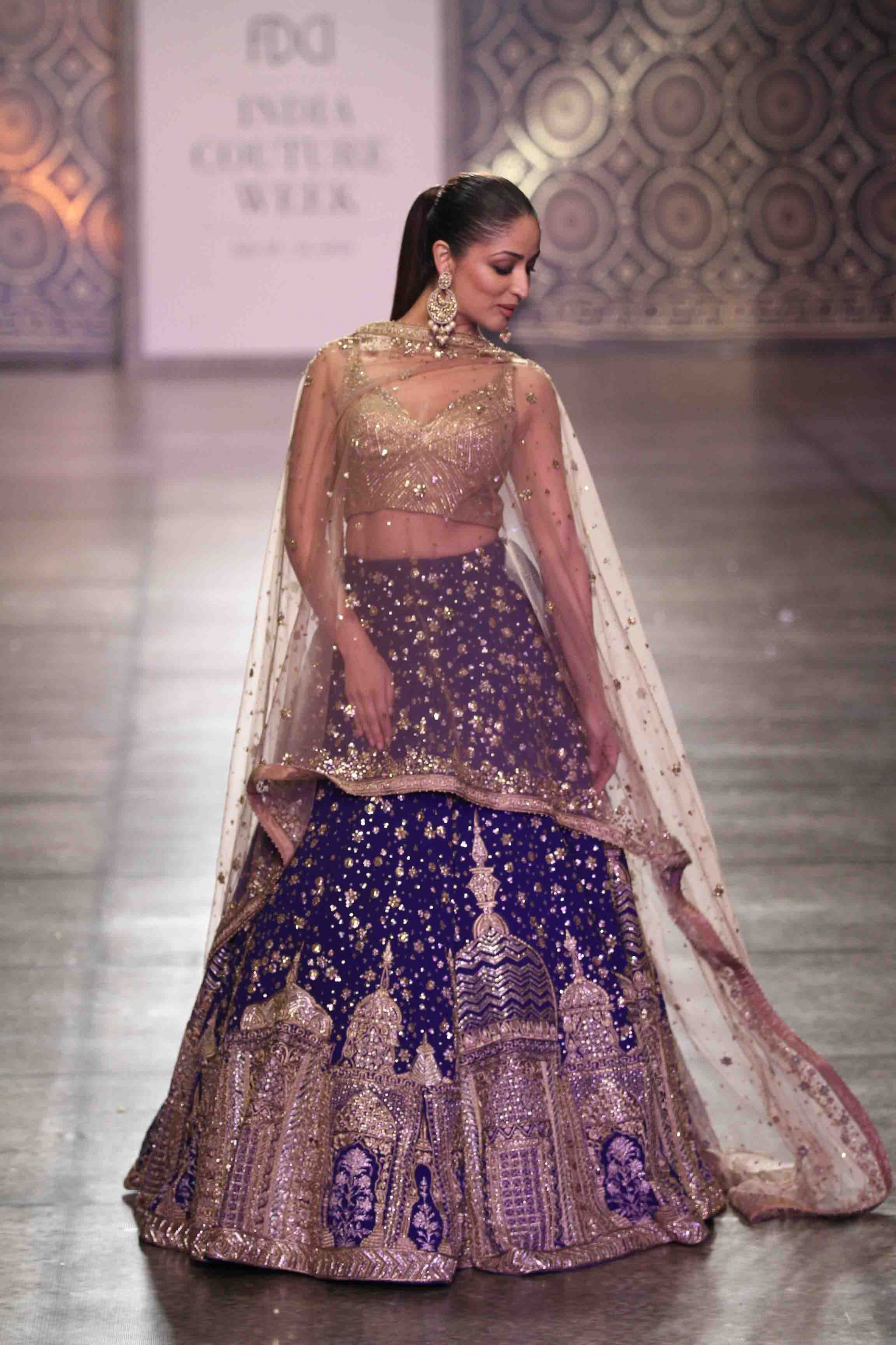 Bollywood actress Yami Gautam in Violet lehenga choli ...