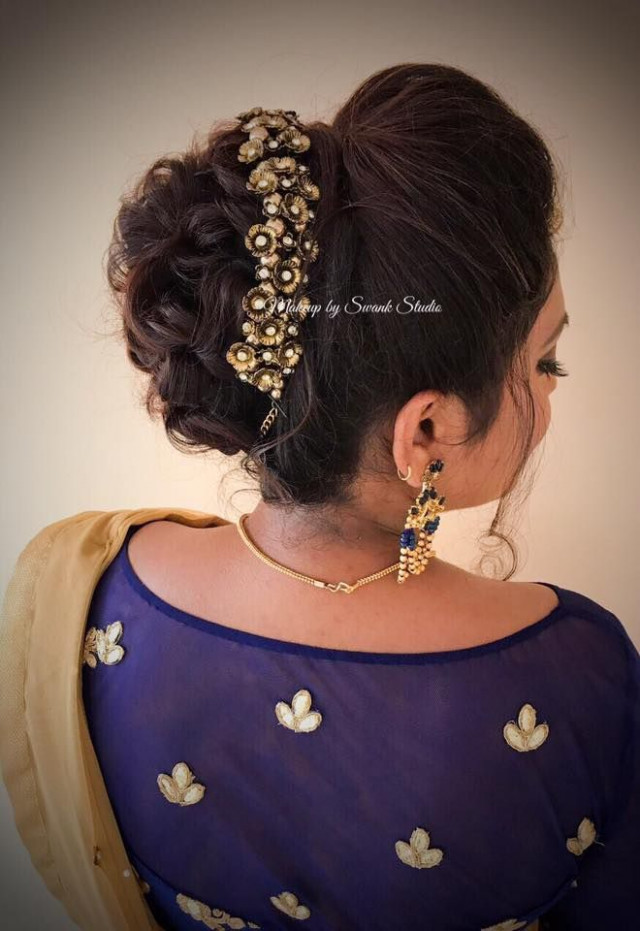 Bridal updo for reception by Swank. South Indian bride ...