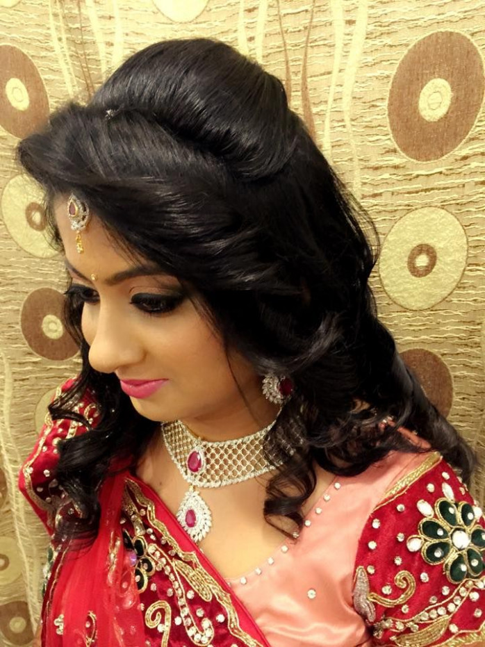 Indian bride's bridal reception hair. Hairstyle by Swank ...