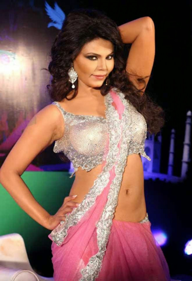 Rakhi Sawant Hot Cleavage and Navel HD Wallpapers in Pink ...