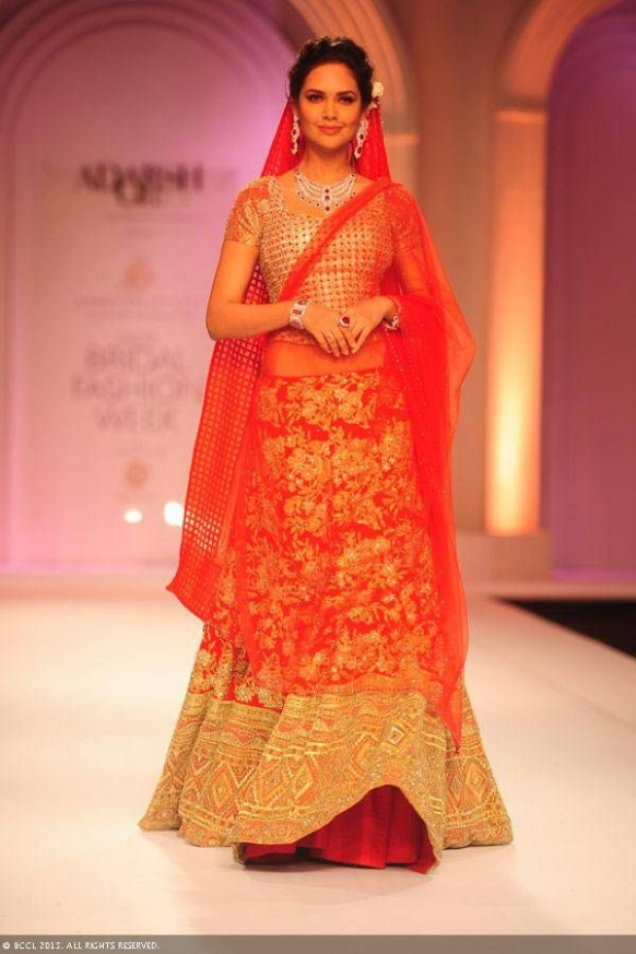 red and gold bridal lehenga, Bollywood actress Esha Gupta ...