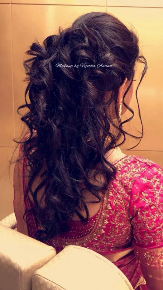South Indian bridal hairstyle for reception. Hairstyle by ...