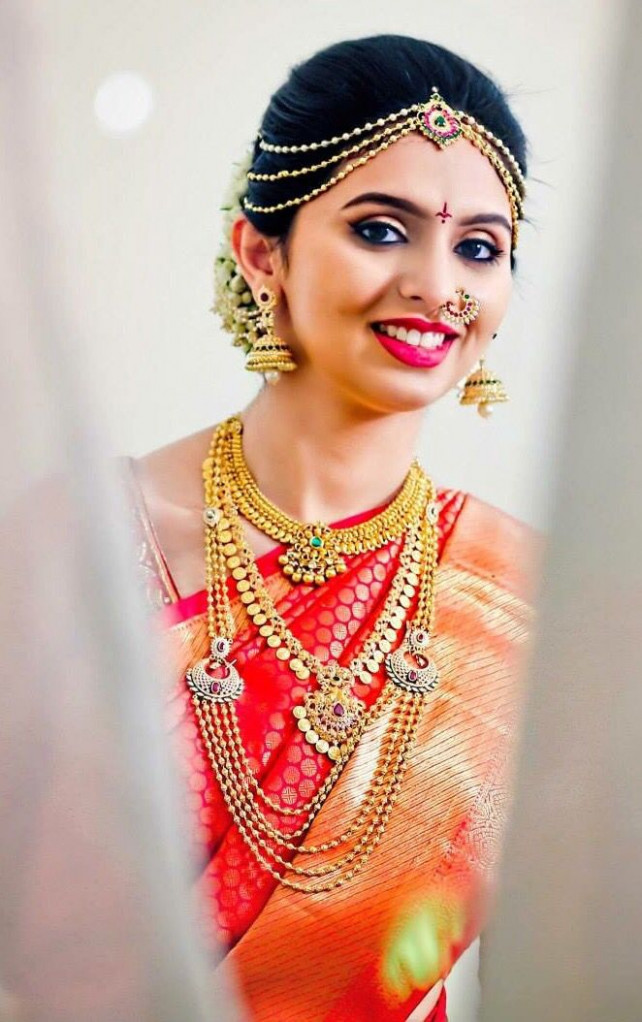 South Indian bride. Gold Temple jewelry. Jhumkis ...