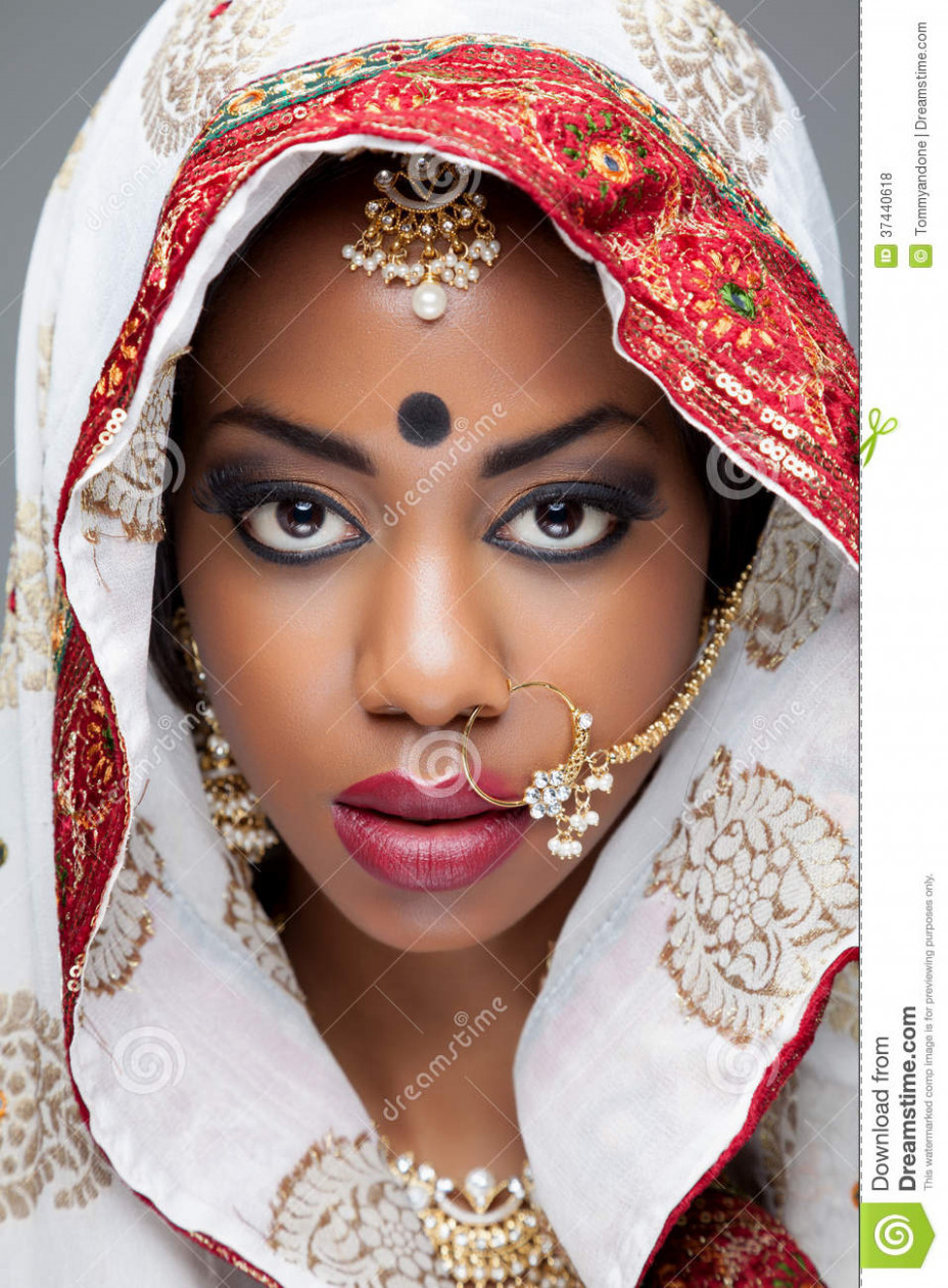 Young Indian Woman In Traditional Clothing With Bridal ...
