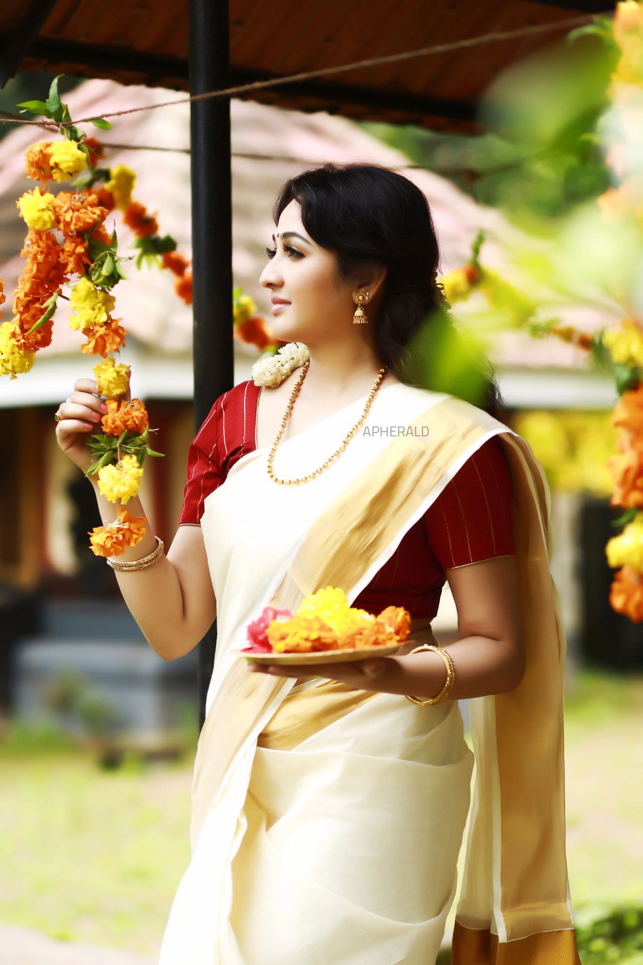 8 Photos of Actress Aavana in ONAM SAREE is a perfect