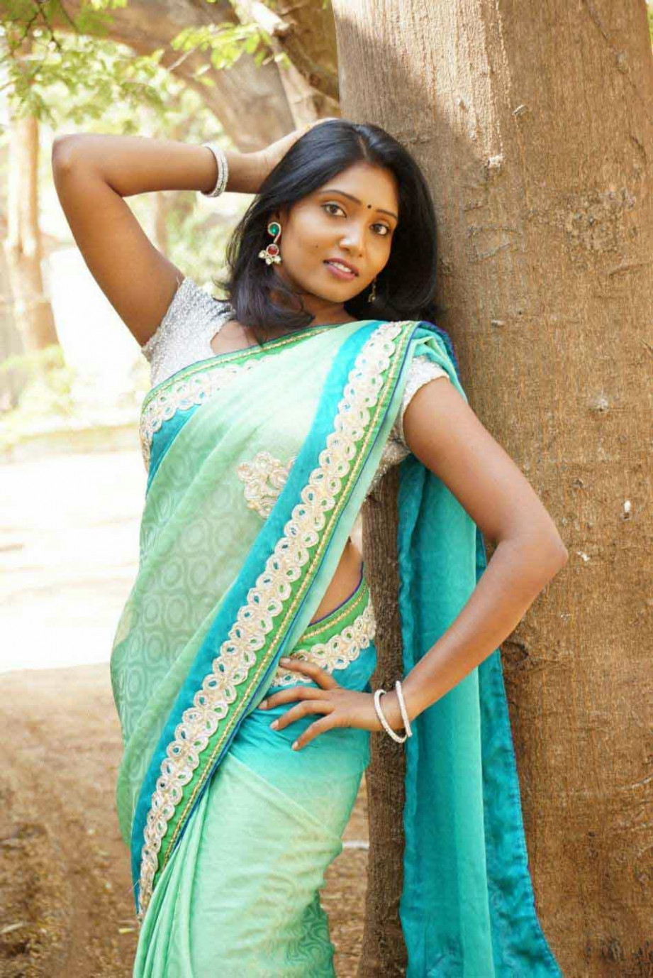 Actress Eesha Hot Looks Saree Stills - shows spicy pose