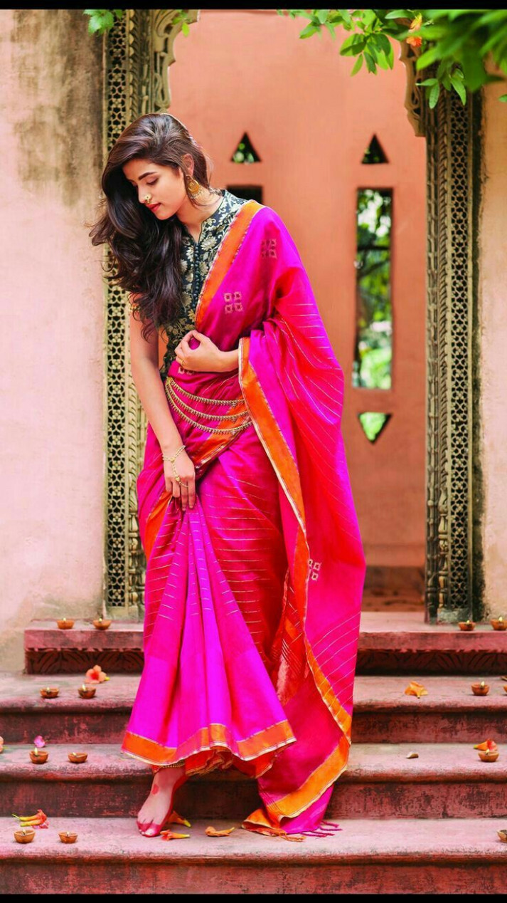 Beautiful fuschia saree with a smart printed blouse