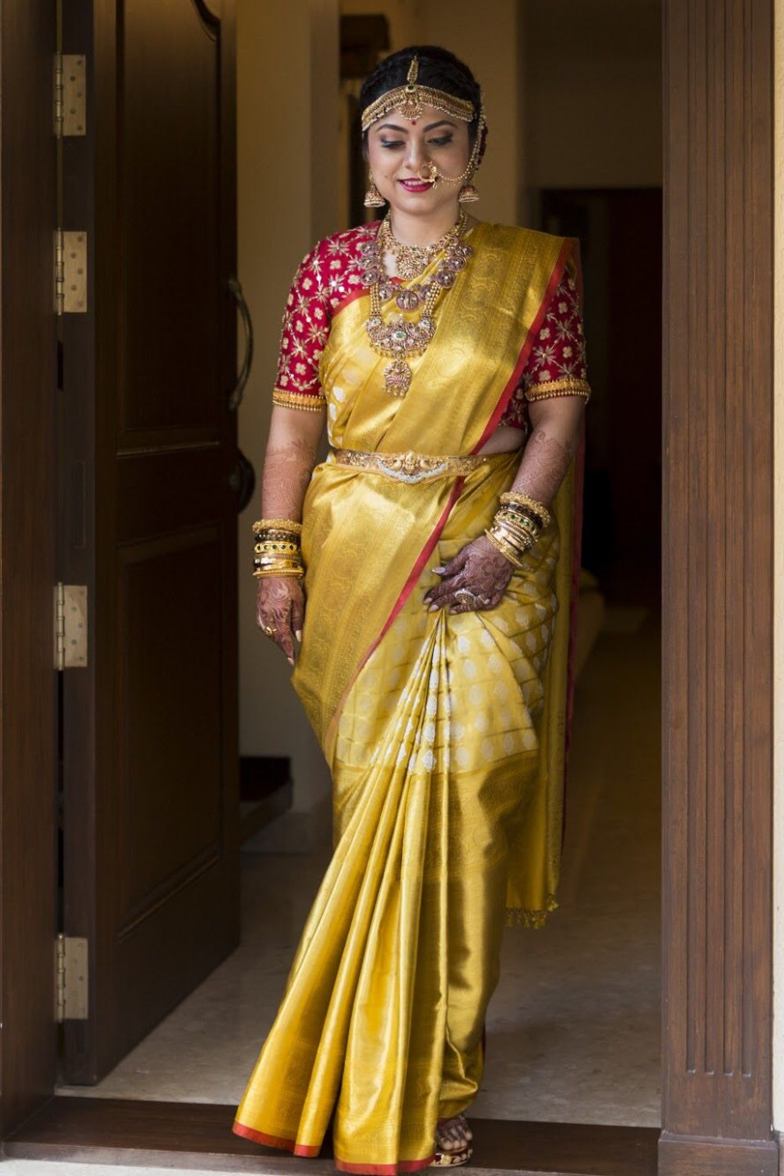Bride in Golden saree and Red designer blouse. Photography