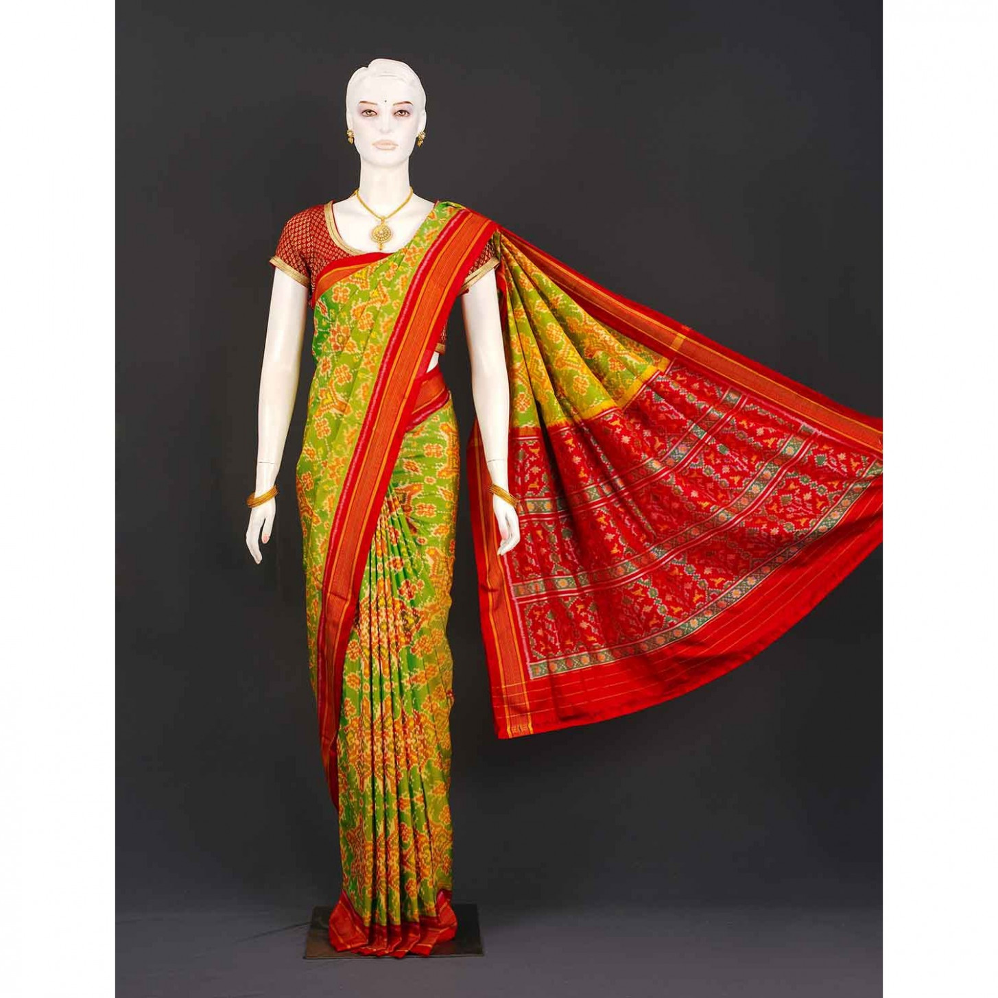 Bright green with red contrast patola silk saree  Shree
