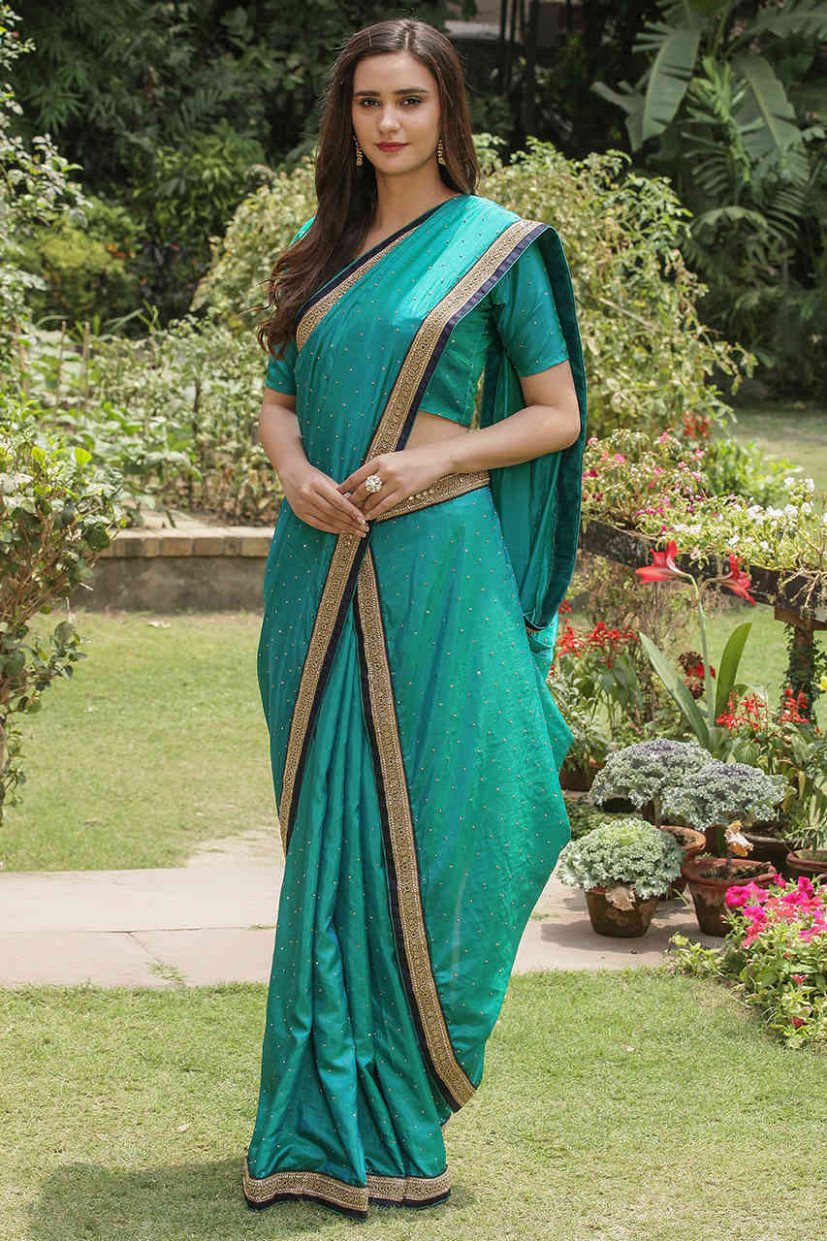 Designer Sarees for Women: Buy Glinting Dark Green Saree