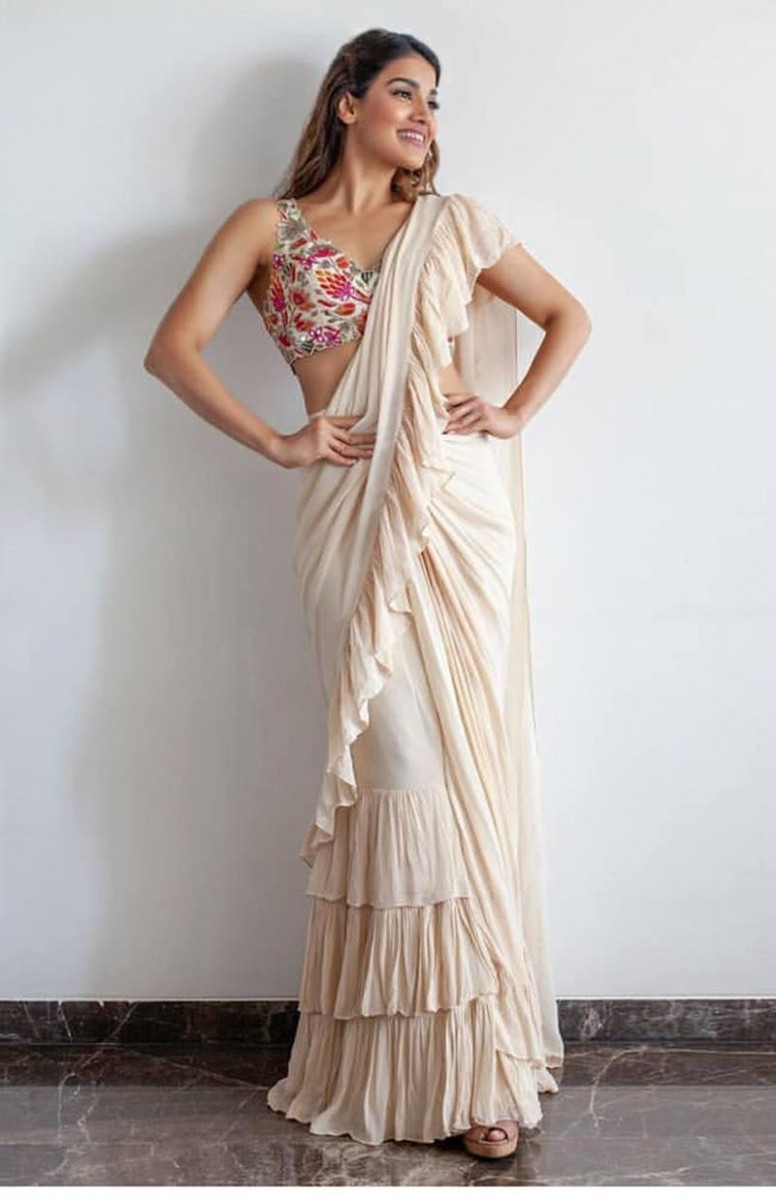 Desirable Off White Georgette Solid Ruffle Saree With