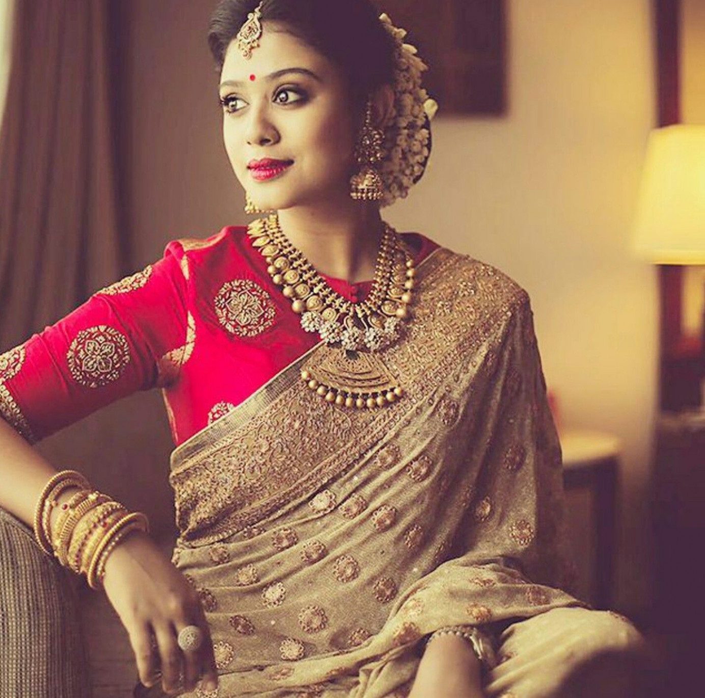 Gold jewelry, silk sari and blouse, and fresh jasmines in