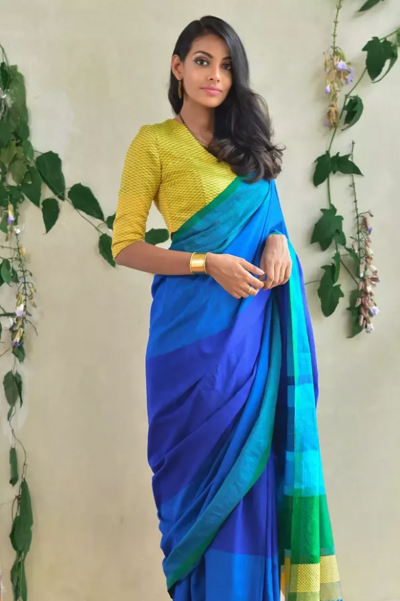 How should a saree be draped at the office in order to