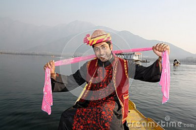 Indian Man Dancing To Folk Song With Pink Shawl Stock