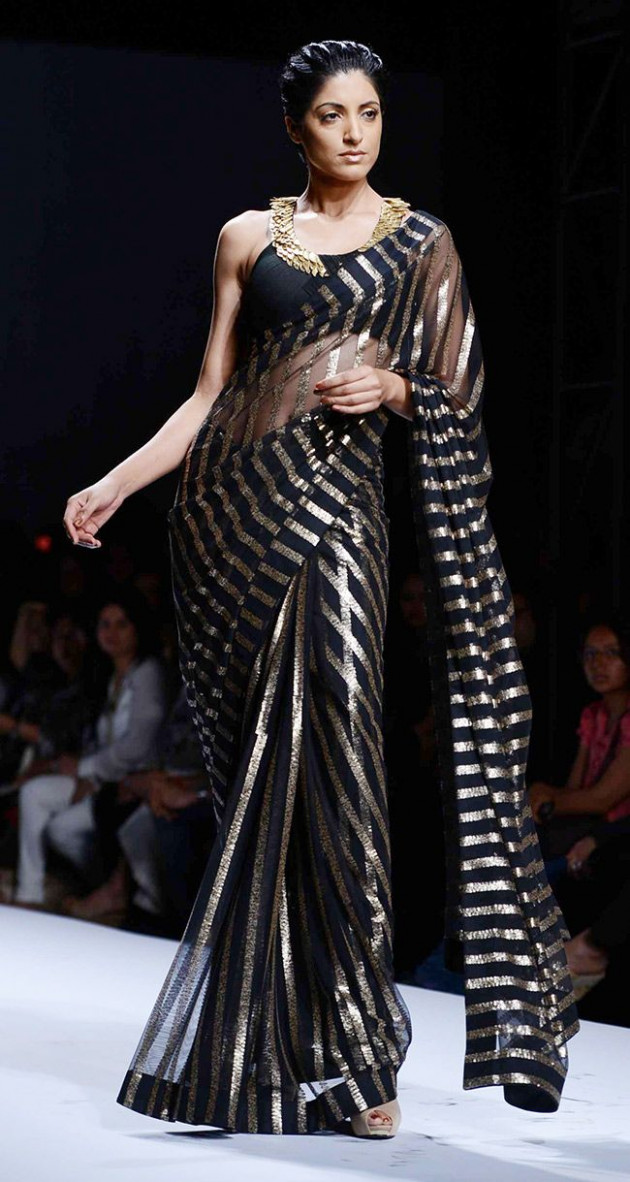 Jesse Randhawa for designer Reynu Tandon in a black & gold