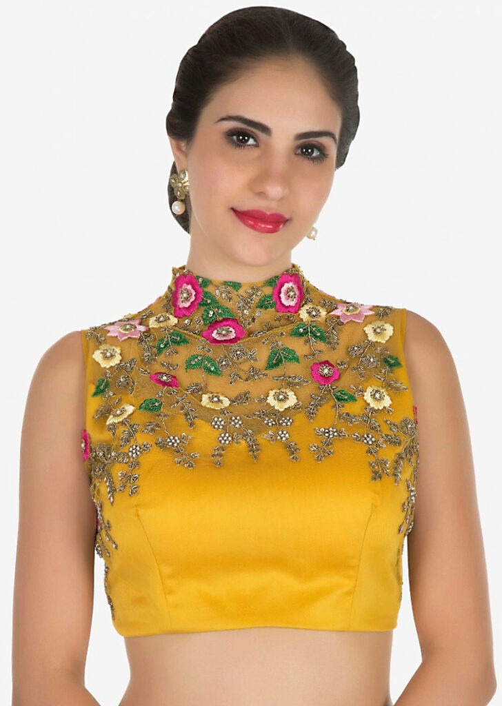 Mustard ready pleated saree with a high neck blouse