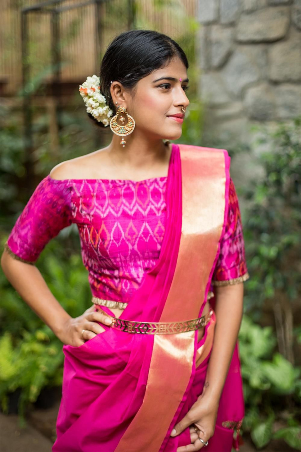Off shoulder sari blouse, silk sari and a gold belt