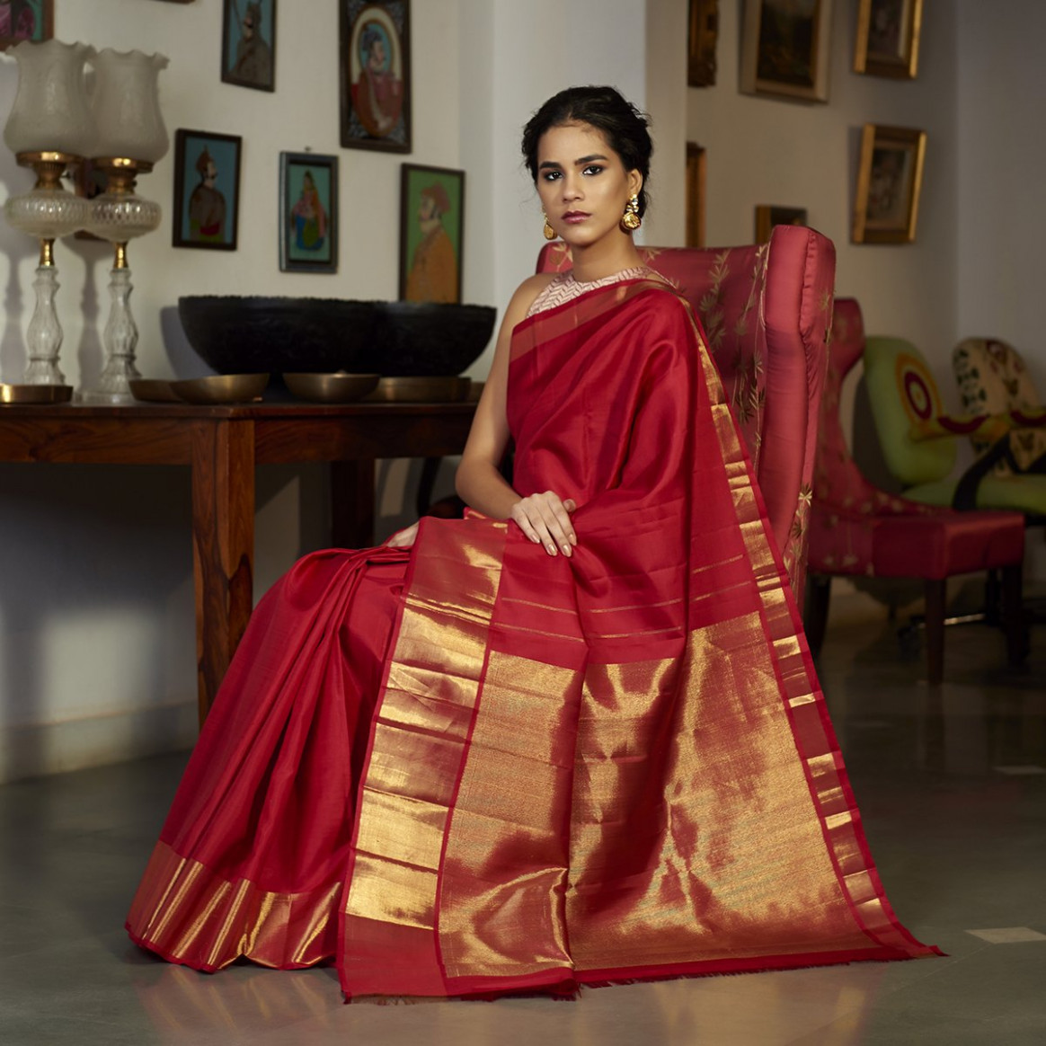 Red Kanjivaram silk saree with a solid gold zari border