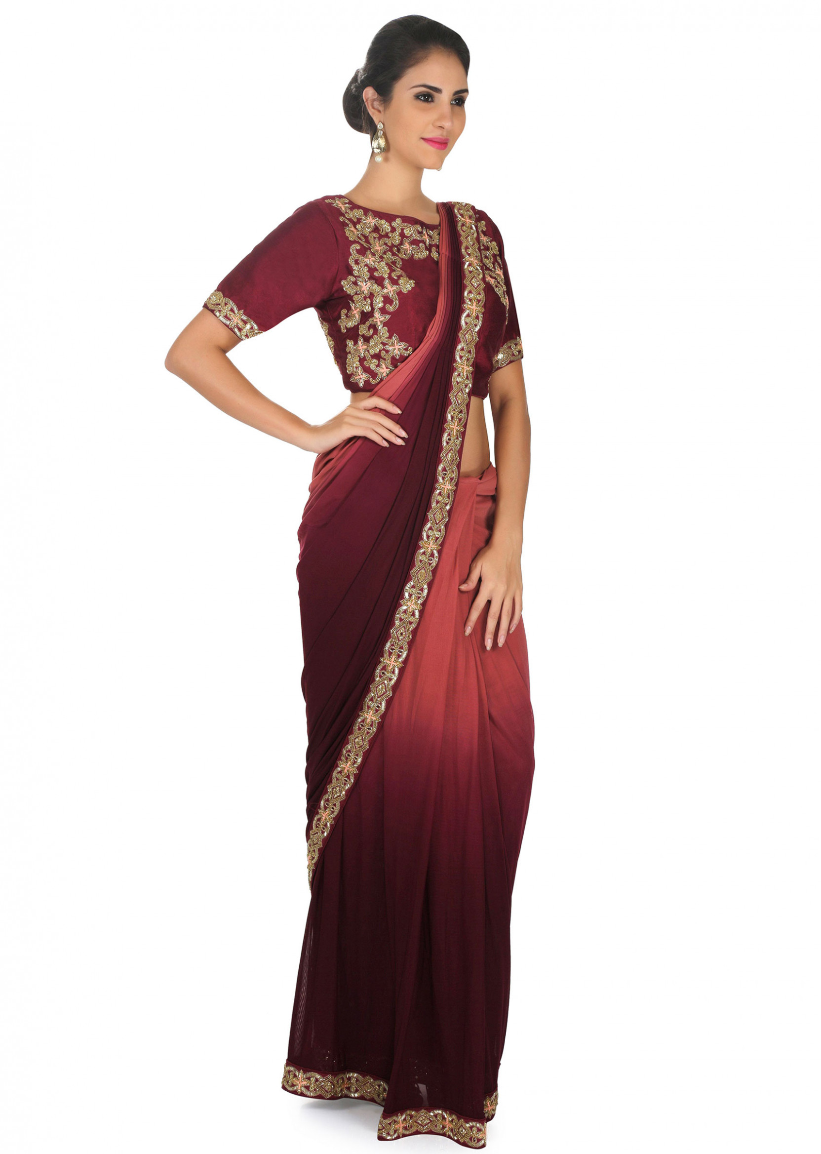 Rust and wine pre stitched saree with burgundy ready blouse