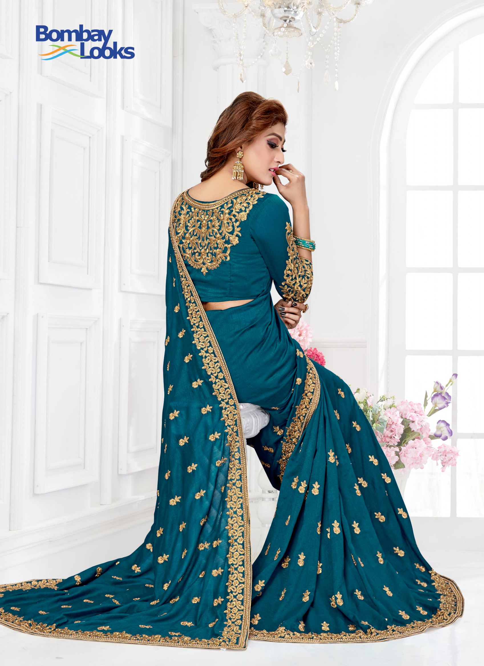 Sarees: German Blue Saree with stylish Embroidered Boat