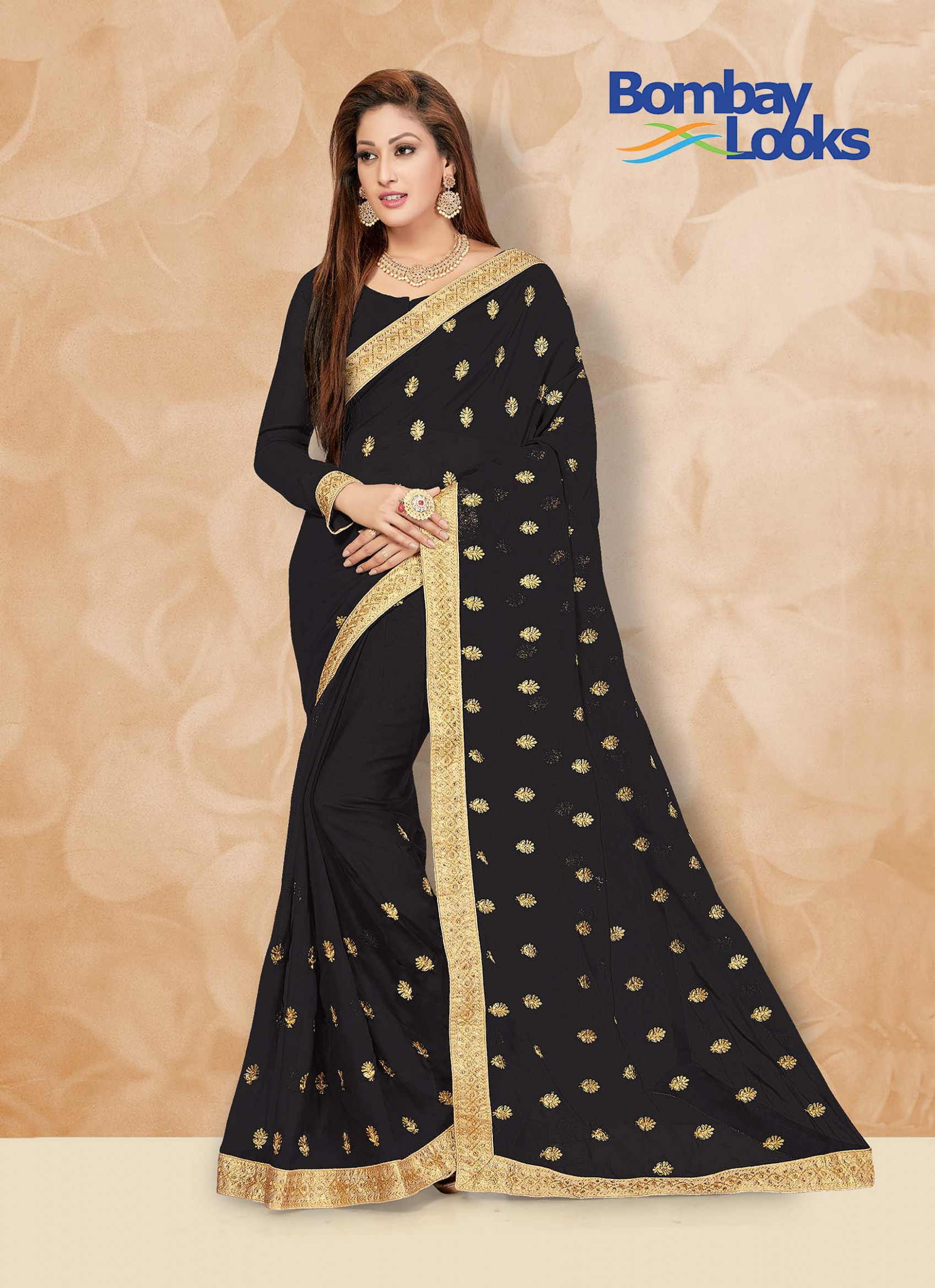 Sarees: Soft Georgette black saree with elegant gold border