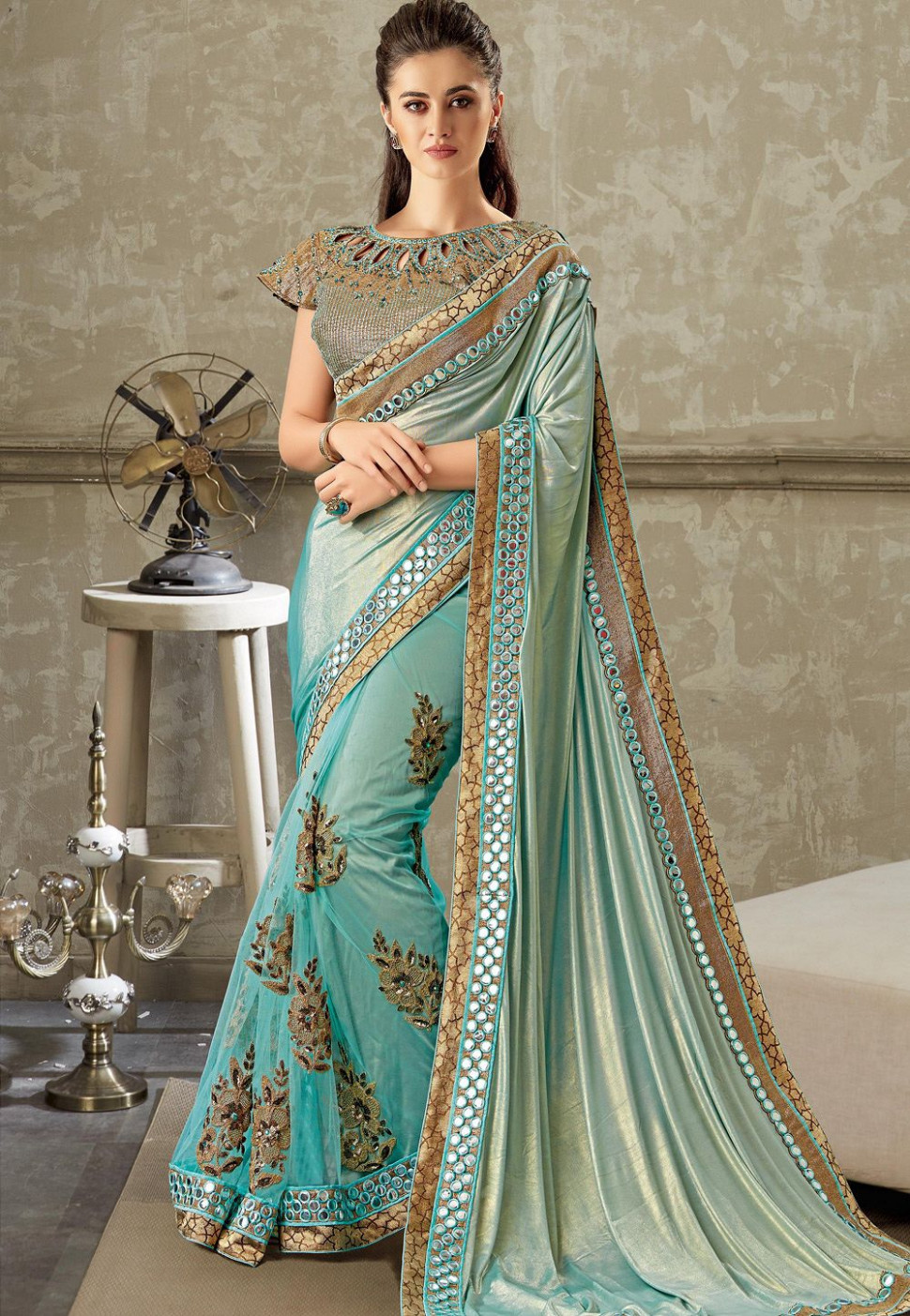 sky blue embroidered lycra net saree with brocade blouse 10716