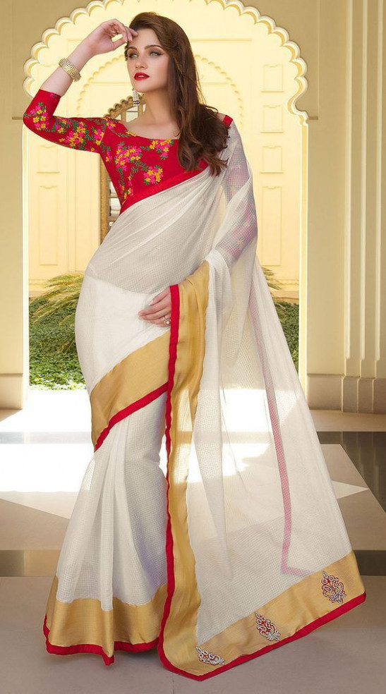 White saree with gold and red borders. Red blouse  Saree