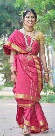 Why do Brahmin brides wear 9 yard long red saris for their