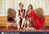 Indian bride and groom in traditional wedding dress ..