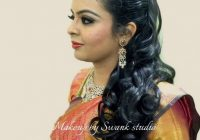 Indian bride's reception hairstyle by Swank Studio. Curls ..
