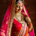 Lovely indian bride posing in her hot pink wedding attire ..