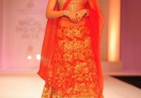 red and gold bridal lehenga, Bollywood actress Esha Gupta ..