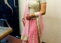 Traditional Indian bride wearing bridal hair, lehenga and ..