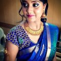 Traditional South Indian bride wearing bridal saree and ..